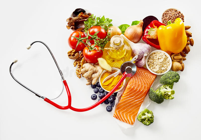 Food ingredients in heart with stethoscope royalty free stock images