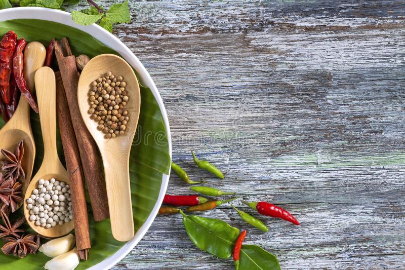 Food ingredients, peppercorn, star anise and chili on wooden table, asian food cooking concept.  stock image