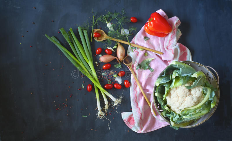 Food ingredients and wooden spoons,. Flat lay on dark background. Vegetarian food,cooking concept royalty free stock photography