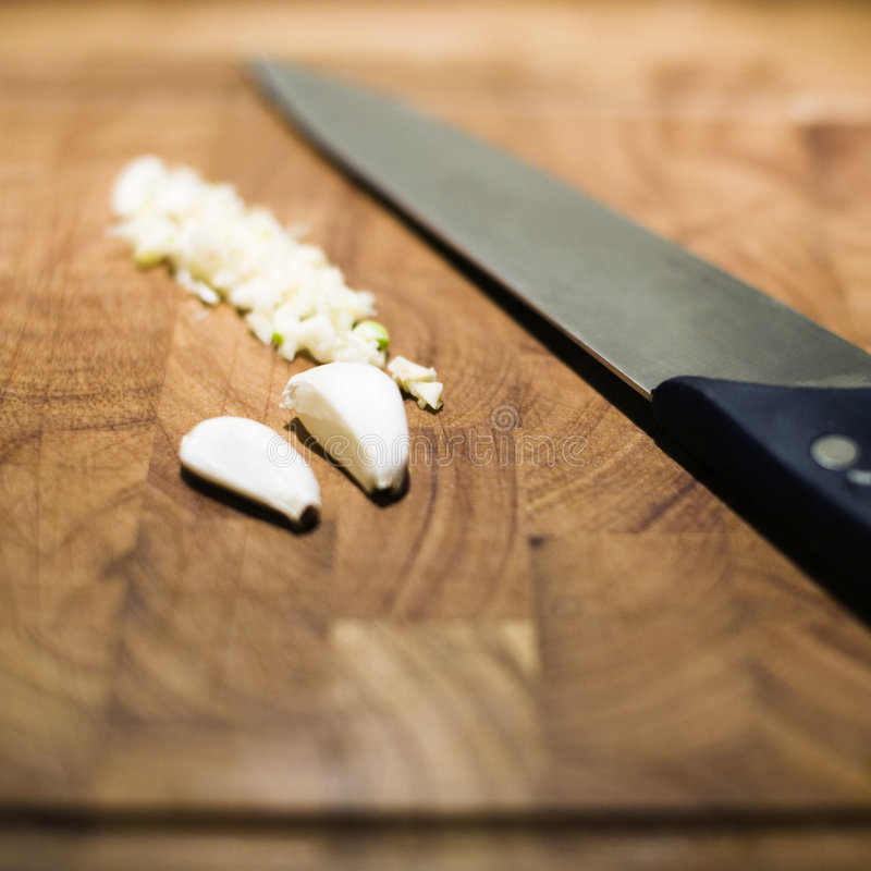 Food items on cutting board stock photos