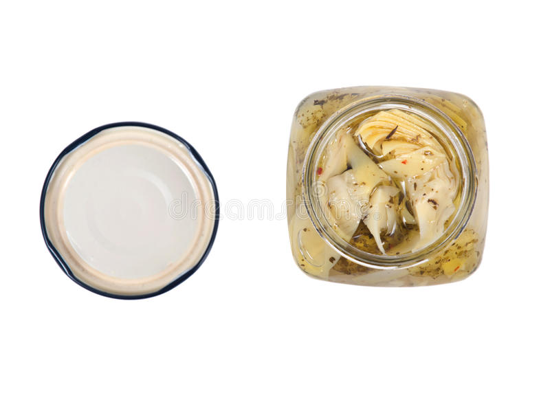 Food of love, marinated artichokes. In jar isolated on white background royalty free stock images