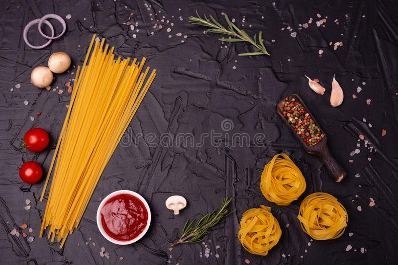 Food, Macaroni, Pasta, Spaghetti. Composition from pasta. Which can be used as a background royalty free stock image