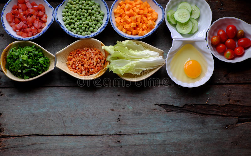 Food material for fried rice. Vietnam food, fried rice, make from rice, egg, sausage, dried shrimp, bean, cucumber, tomato, carrot and scallion, processing with stock photography