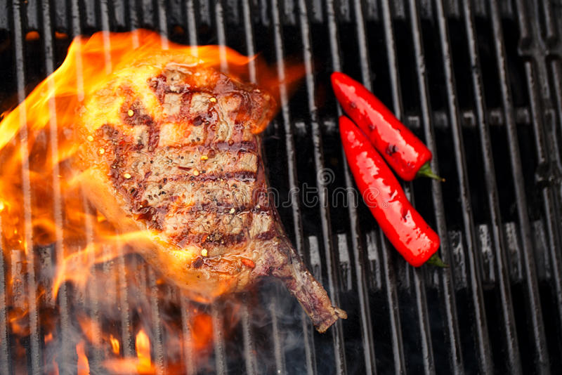 Download Food Meat - Beef Steak On Bbq Barbecue Grill With Flame Stock Photo - Image of barbequing, outdoor: 79721122