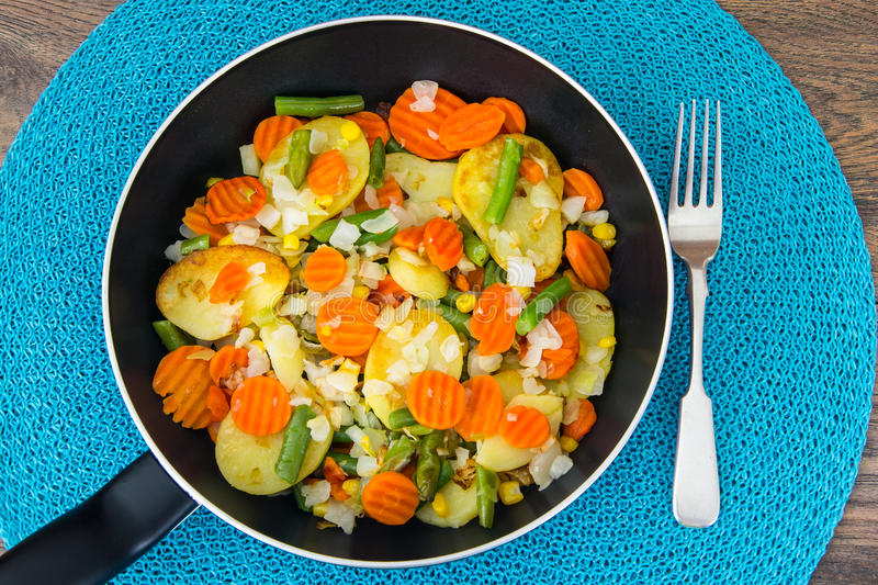 Food without meat:fried vegetables in frying pan stock photos