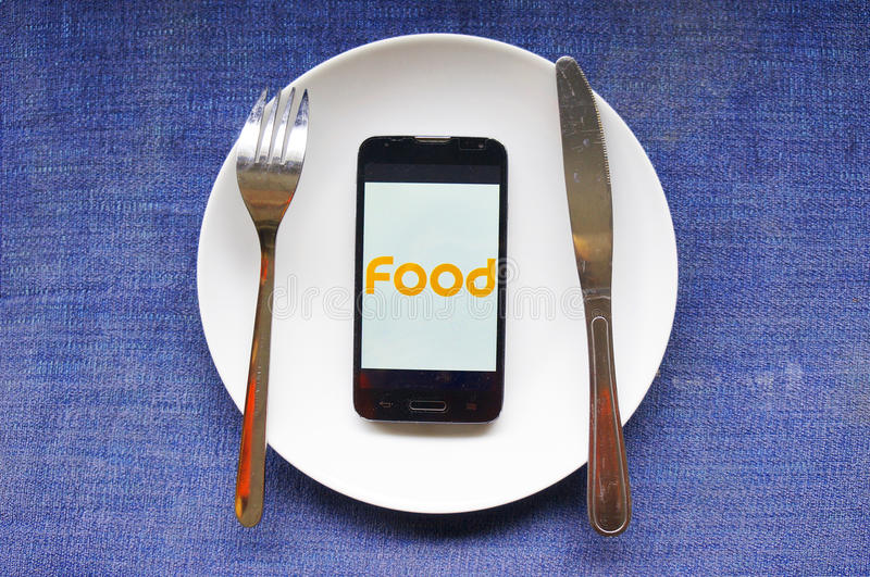 Food for modern people. Nowadays, more and more people regard cell phone as the most important thing in their life. Its the only thing they care about and seems royalty free stock image