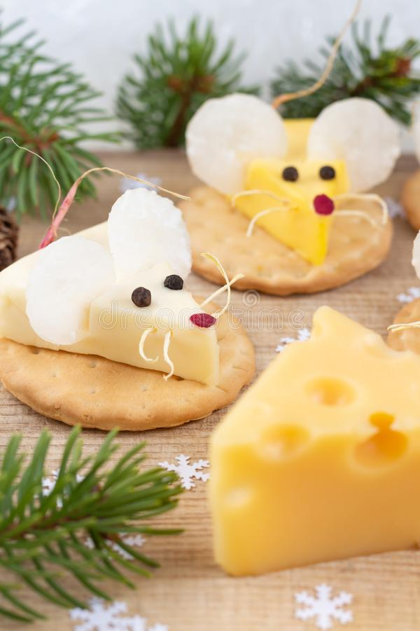 Food for New Year 2020 - year of the white mouse rat. Mice shaped cheese snack. Festive mood stock images
