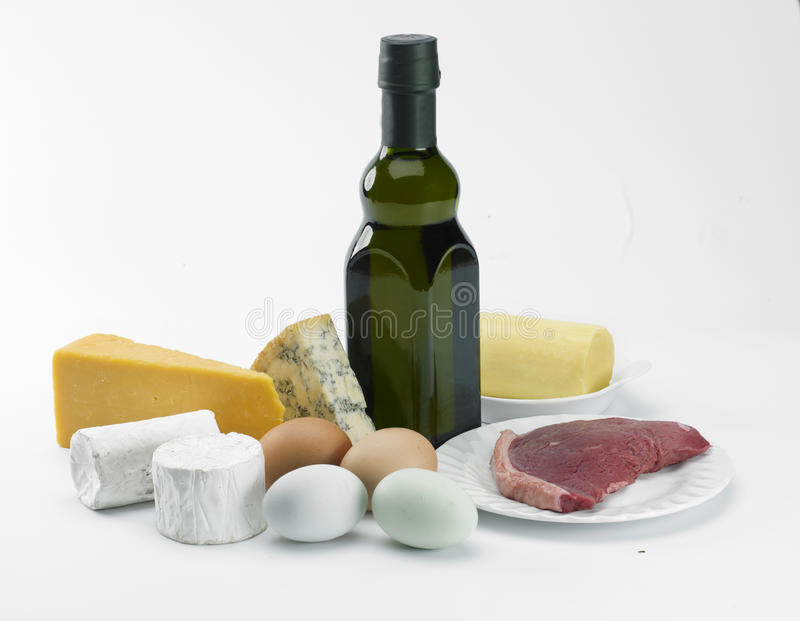 Food and oil. A selection of dairy food items, beef and a bottle of olive oil royalty free stock photos