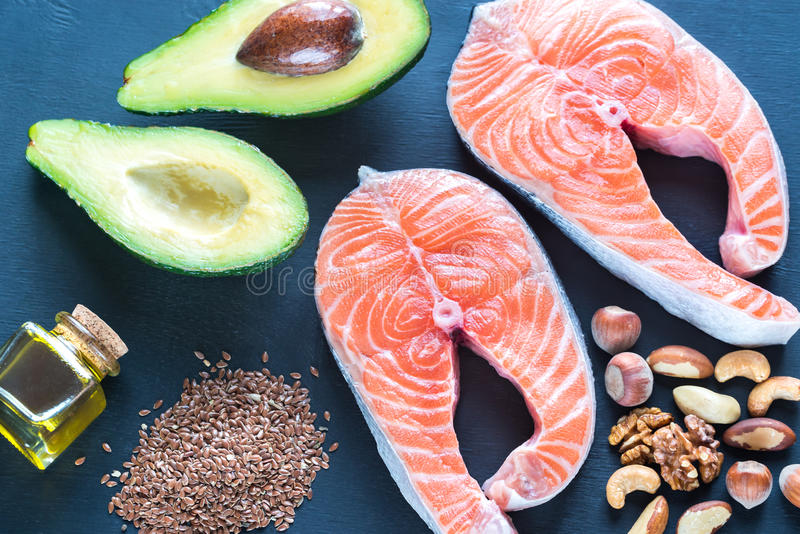Food with Omega-3 fats. On the wooden board stock images