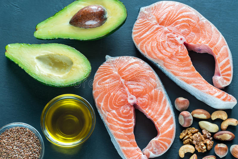 Food with Omega-3 fats. On the wooden board royalty free stock photo