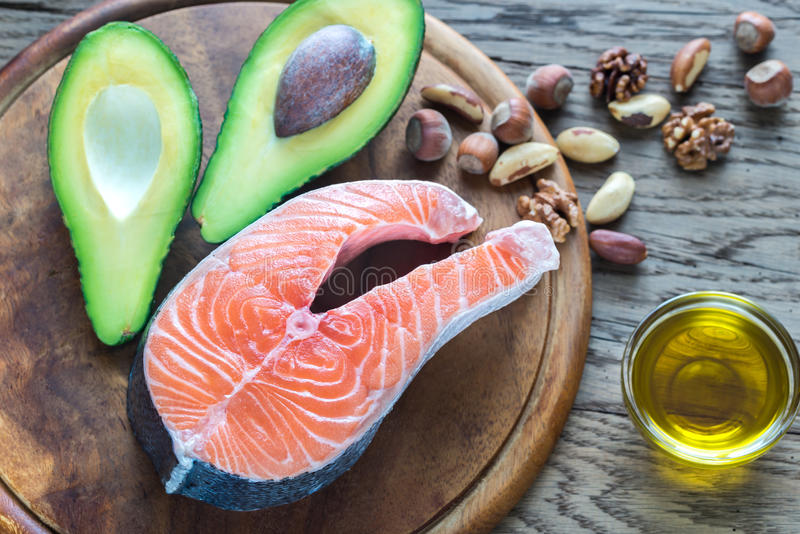 Food with Omega-3 fats. On the wooden board stock photo