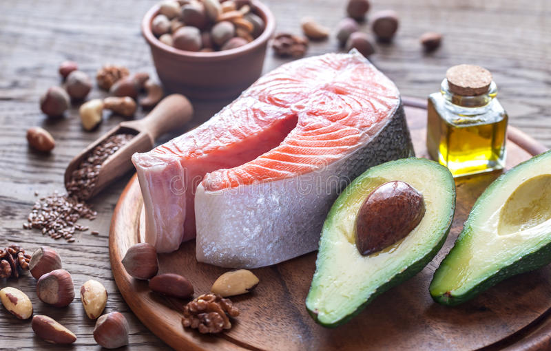 Food with Omega-3 fats. On the wooden board stock image