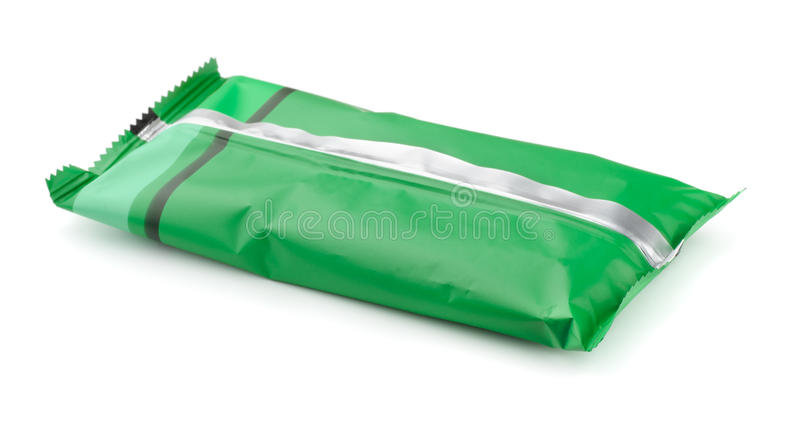Food package. Green foil food package isolated on white royalty free stock photography