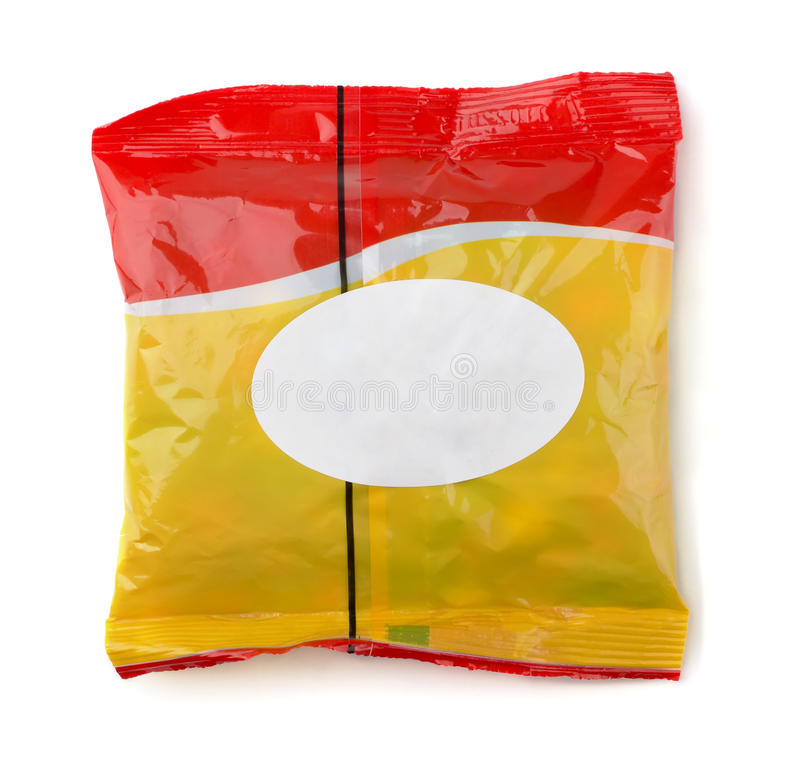 Food packet. Red and yellow food packet with white label isolated on white stock image