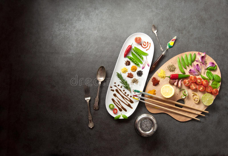 Food palette concept. Painters food seasoning palette with colorful herbs` spices and fresh ingredients royalty free stock photo
