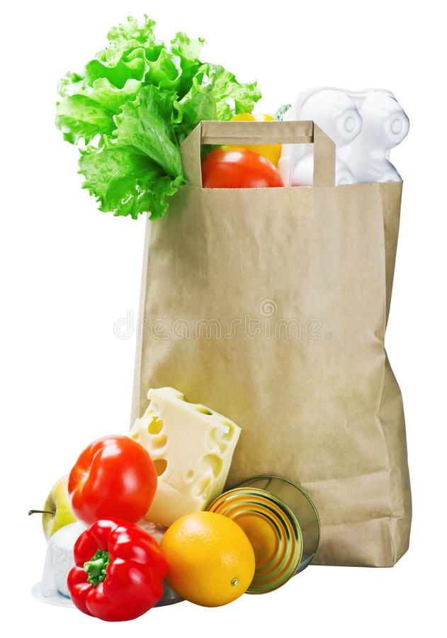 Food in a paper bag. Isolated on white background royalty free stock photography