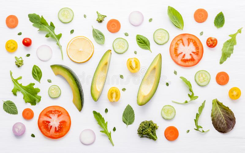 Food pattern with raw ingredients of salad, lettuce leaves, cucumbers, tomatoes, carrots, broccoli, basil ,onion and lemon flat l royalty free stock photography