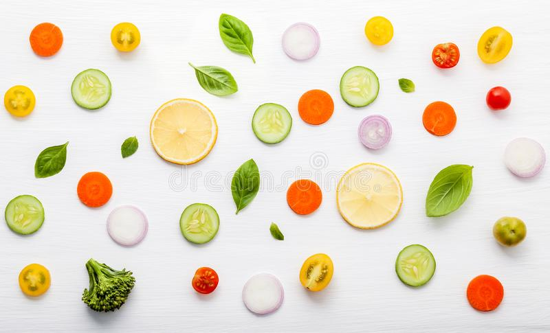 Food pattern with raw ingredients of salad, lettuce leaves, cucumbers, tomatoes, carrots, broccoli, basil ,onion and lemon flat l royalty free stock images