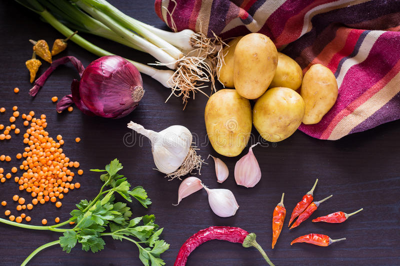 Food photo with fresh organic vegetables on dark wooden rustic background, top view. royalty free stock image