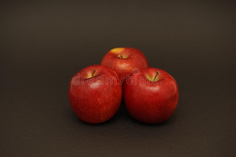 Fresh red apples in macro. Food photography. apple capture in flash light royalty free stock photography