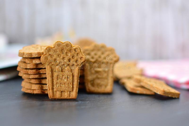 Home baked cookies made with a cutter in the shape of popcorn bags royalty free stock images