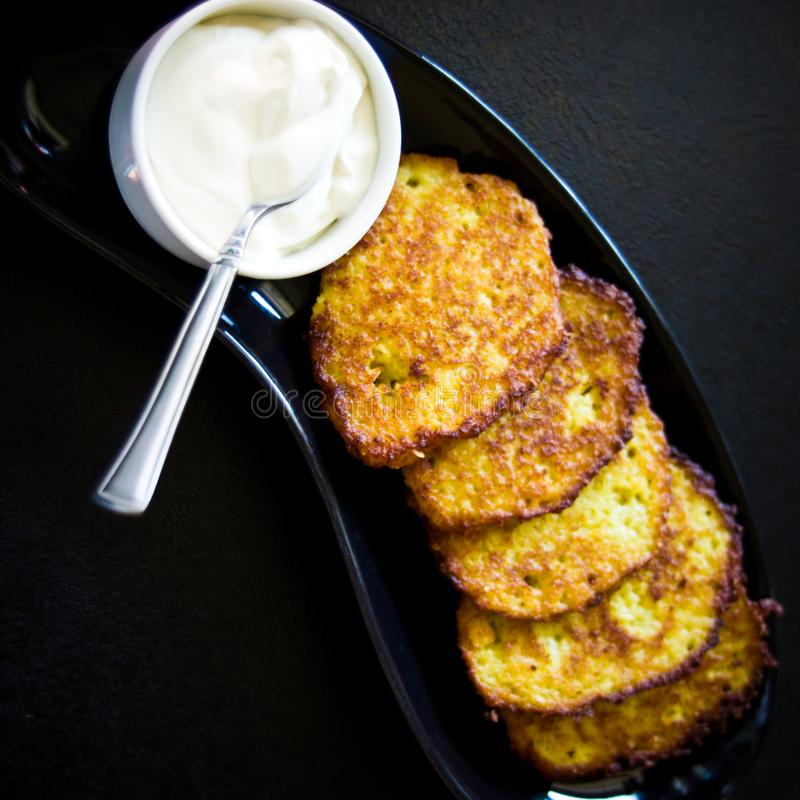 Potato pancakes with cream homemade royalty free stock photos