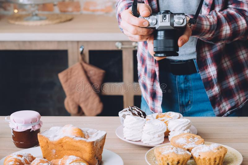 Food photography pastry dessert man photo meringue. Food photography. Pastry dessert assortment. Man with camera taking photos of plate with meringue stock photos
