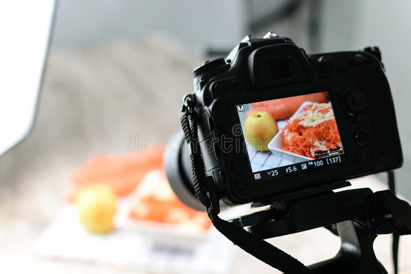 Food photography production. Concept image - rear view of DSLR camera making a food photography in the photo studio stock image