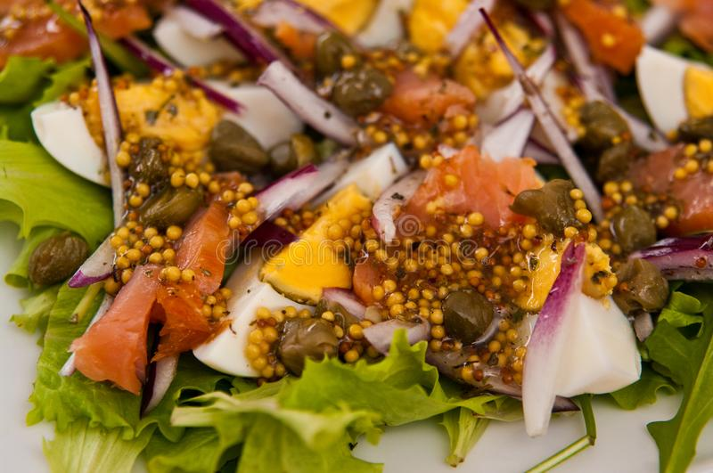 Eggs salad with salmon and capers stock photo