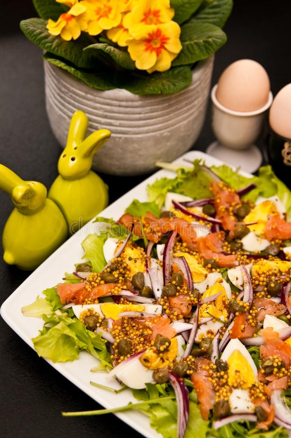 Eggs salad with salmon and capers stock image