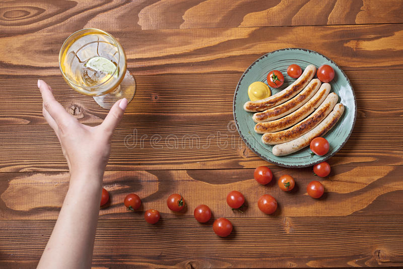Food plate of traditional german fried sausages with beer and to royalty free stock photography