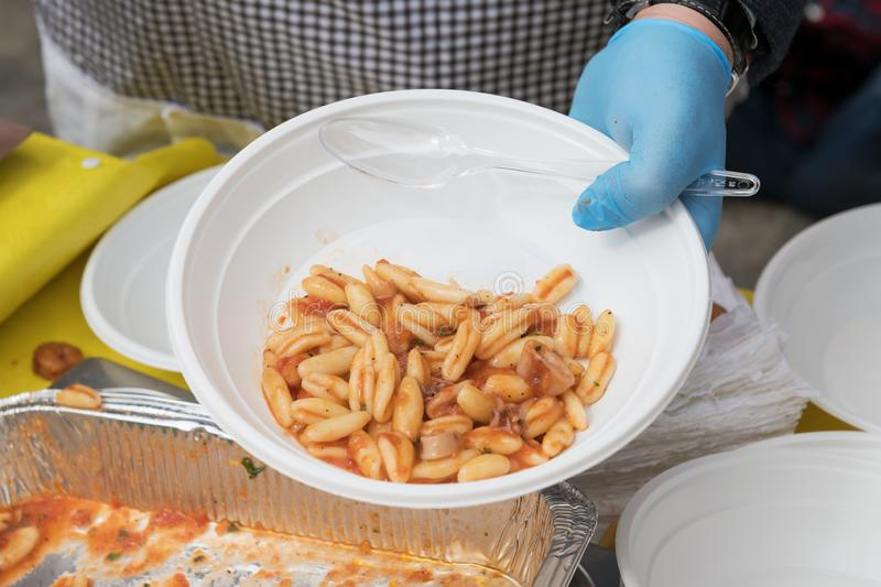 Food for the poor to feed the hungries, concept of food donation, distribution of italian pasta to the needies stock photo
