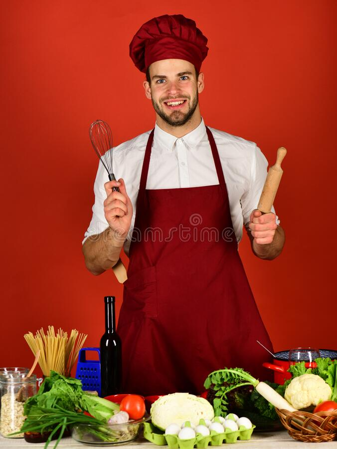 Food preparation concept. Cook works in kitchen stock image