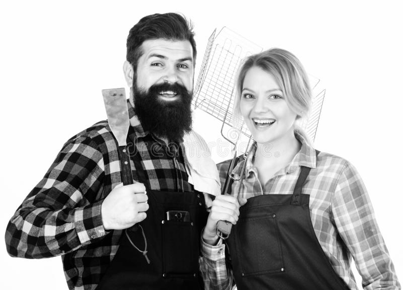 Food preparation. Family weekend. Man bearded hipster and girl. Preparation and culinary. Tools for roasting meat royalty free stock image