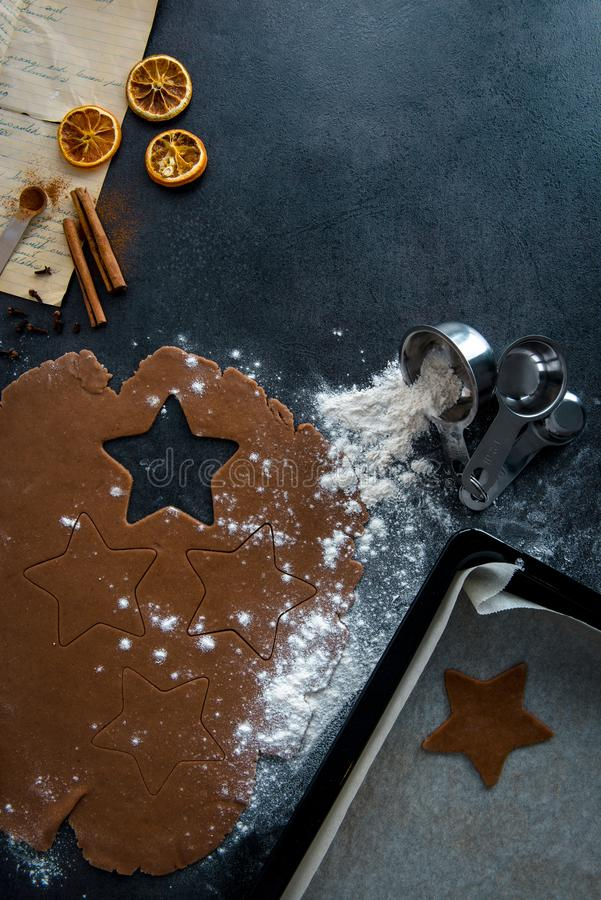 Food preparation. Star shape cutout in gingerbread dough. stock photos