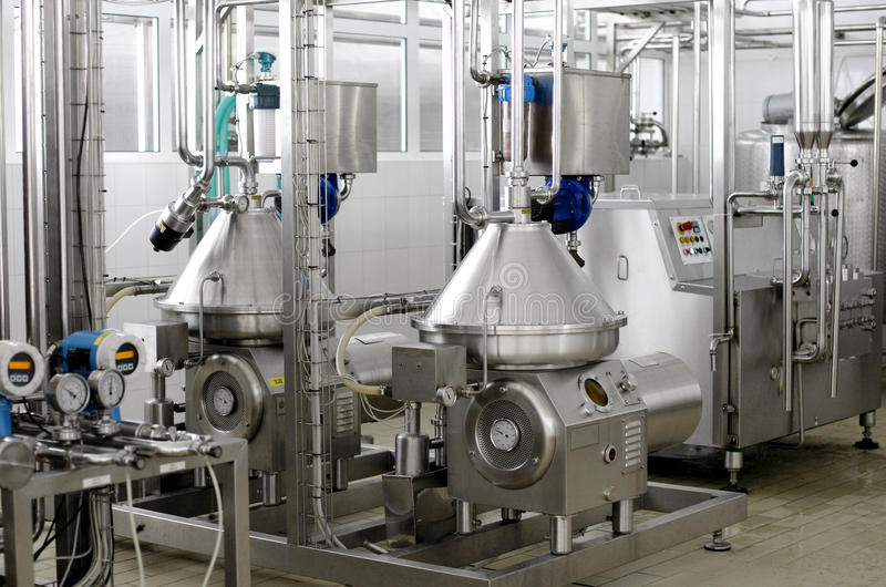 Food processing industry. Stainless steel temperature controlled pressure tanks in factory stock photos