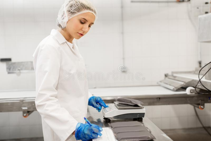 Woman working at ice cream factory royalty free stock photo