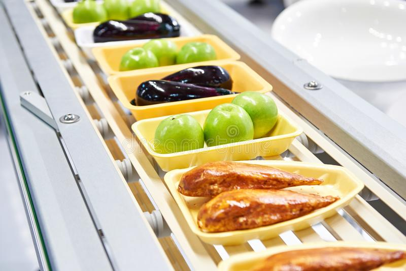 Food products in plastic pack on conveyor stock images