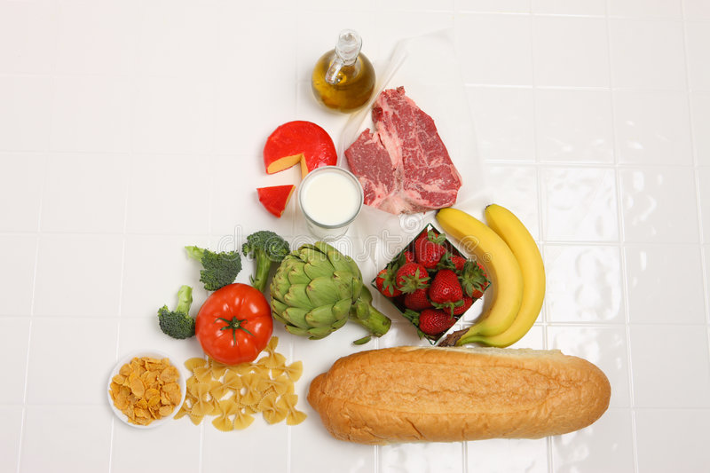 Food Pyramid. Group of food products arranged in shape of pyramid stock photo