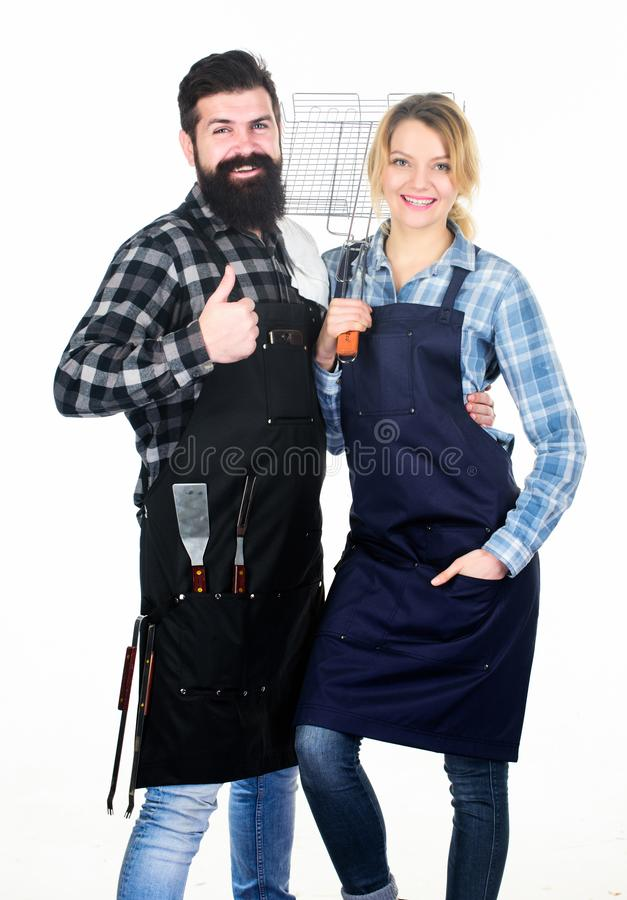 Food quality. Family weekend. Man bearded hipster and girl. Preparation and culinary. Tools for roasting meat. Couple in royalty free stock photos