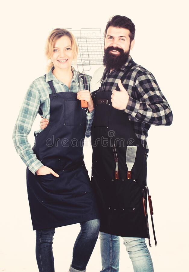 Food quality. Family weekend. Man bearded hipster and girl. Preparation and culinary. Tools for roasting meat. Couple in stock photo