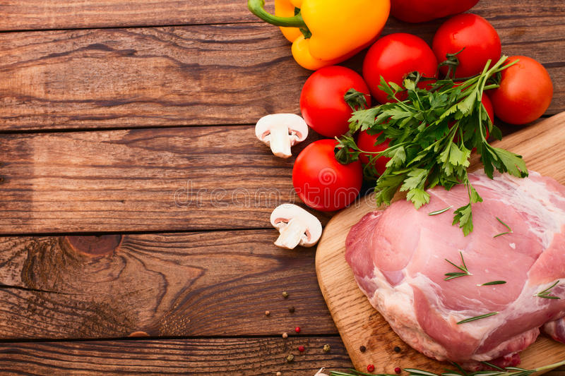 Food. Raw meat for barbecue with fresh vegetables royalty free stock photography
