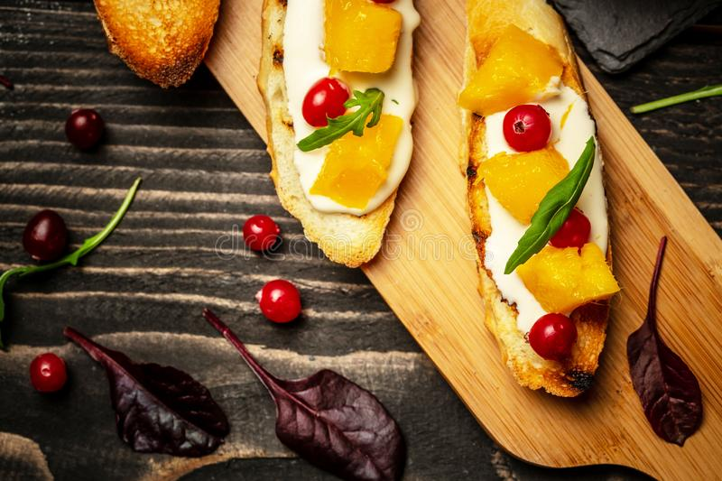Food recipe concept. Toasts of cheese, Alphonso mango. Bruschetta with mango and cheese. Homemade. Healthy vegetarian nutritionon stock photos