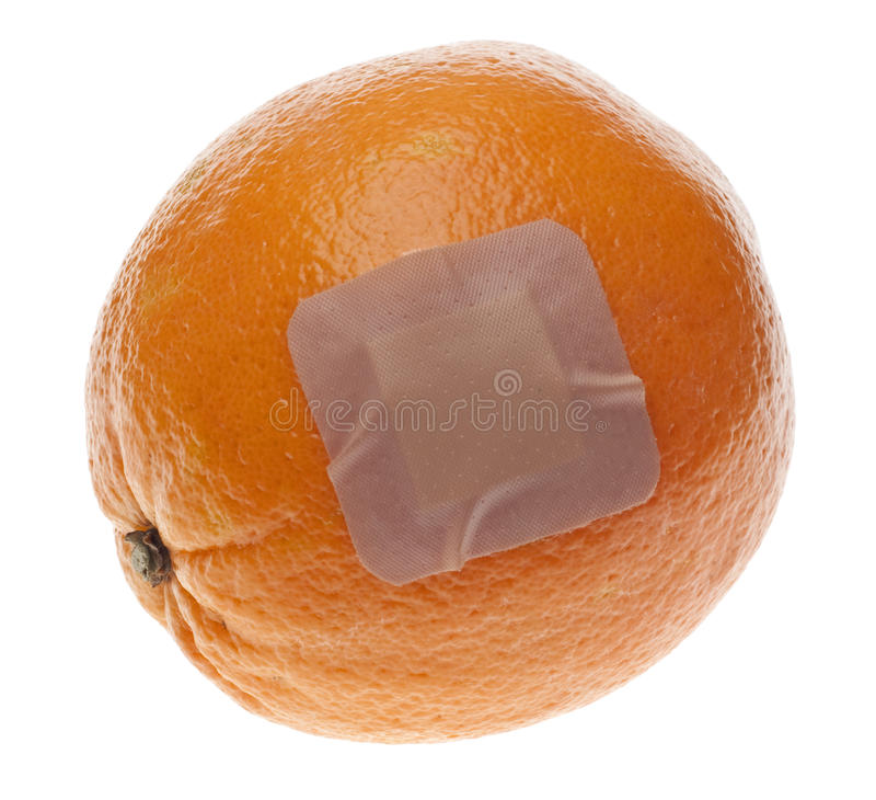 Food Safety. Concept with Orange and Bandage Isolated on White with a Clipping Path royalty free stock photo