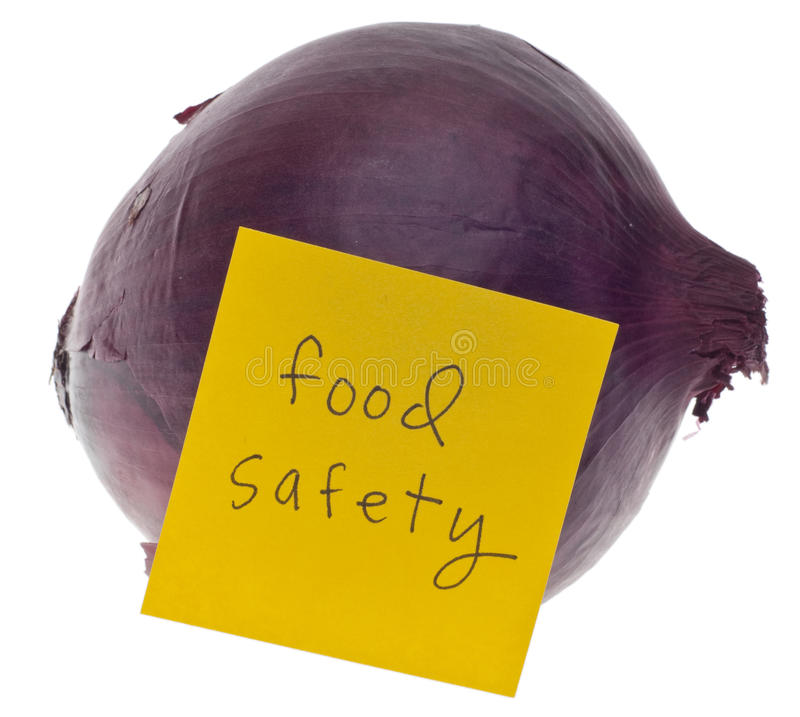 Food Safety. Red Onion and Note Saying Food Safety Isolated on White with a Clipping Path stock photography