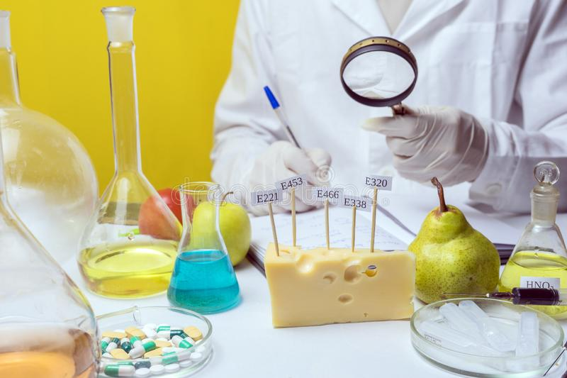 Food safety laboratory procedure, lab assistant analysing fruits from the market. Food safety laboratory procedure, analysing fruits from the market royalty free stock photography