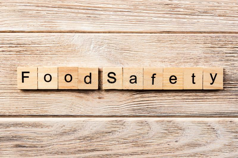 Food safety word written on wood block. food safety text on table, concept.  royalty free stock photos