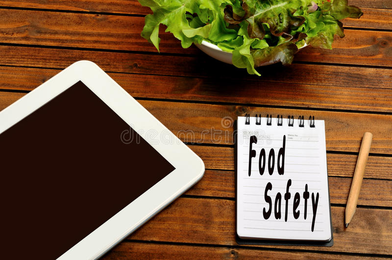 Food safety words. On notebook stock photography