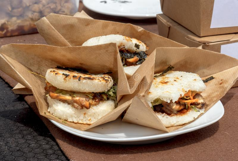 Asian street food cooking, rice buns burgers royalty free stock photography
