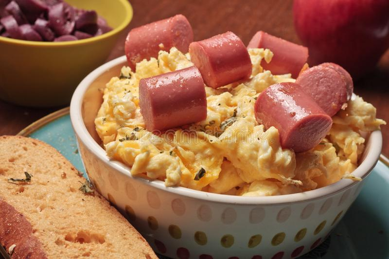 Scrambled eggs with sausage in pieces royalty free stock photos